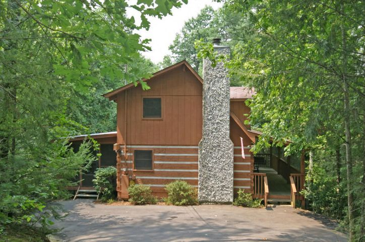 If you are looking for ''Southern Hospitality'' you have found it in this 8 bedroom 7 bath vacation lodge in Eagles Ridge Resort.  This cabin is perfect for group retreats or family reunions.  Spaciously designed with an open living room, dining room and fully equipped kitchen.  Newer remodeled media/game room.  Off the main living area is a fabulous large screened porch with hot tub.  The porch is perfect for large groups, no cramped space here.  If you want a little more privacy there are two large front porches to enjoy morning coffee or afternoon tea.  The lower level features a wonderful sitting area and down stairs a generous size theater/game room.  The master suite offers a whirlpool tub and private bath.  Great investment opportunity and currently on a rental program.
