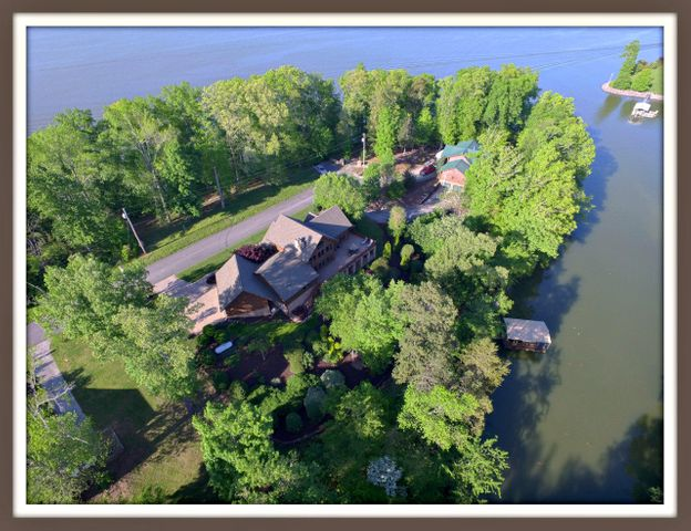 Luxury Log Home on Douglas Lake! One of a kind Hearthstone designed Timber-Frame home located in the Foothills of the Smoky Mtns. Open 1-1/2 story floor plan with Master BR and Living area located on main level. Features vaulted ceilings, walk-out lower level game room, entertainment center, wet bar, tankless gas water heater & more! The landscape complements the natural surroundings with a relaxing Waterfall, Fire-Pit, Hot Tub & spacious deck for entertaining. Follow the flagstone steps down to the lower level deck & boat dock for boating, swimming & fishing on Douglas Lake. Located very close to Historic Downtown Dandridge, the location provides easy access to Knoxville, Gatlinburg, Great Smoky Mtns, Pigeon Forge & attractions. Addt'l sleeping qtrs up to 4 guest suites-3 BR perk.