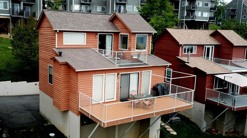 The name says it all...Sky High views! Rare can you live at almost the top of the mountain, yet be in downtown Gatlinburg in about 10 minutes. Or go to Pigeon Forge the ''back way'' This home is not on overnight rental, but it could be. Sold furnished; everything you need is here. The layout feature 2 floors with 2 decks. The upper floor is a private master bedroom retreat--- complete with roomy jetted tub with a view. You'll find it easy to call this home, home away from home, or a nice overnight rental home. It's up to you! Check out all the HOA membership has to offers including 3 pools!: https://chaletvillageownersclub.com/ Come see today!