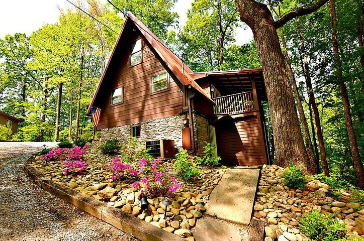 Rustic and spacious 3 bedroom, 3 bathroom 2300 square foot mountain chalet! This chalet is located on a corner lot, only blocks away from Ober Gatlinburg and just minutes to downtown! Inside you have a large living area with vaulted ceilings, an open concept kitchen and dining area. Each bedroom has access to its own private bathroom. The loft level contains a private master bedroom with an in-room whirlpool and a small den overlooking the main level living room. The lower level houses a large recreational room with a pool table, eat-in area, and easy access to the enclosed deck with the hot tub. A lovely chalet that encompasses a sense of comfort and serenity in the Smokies.