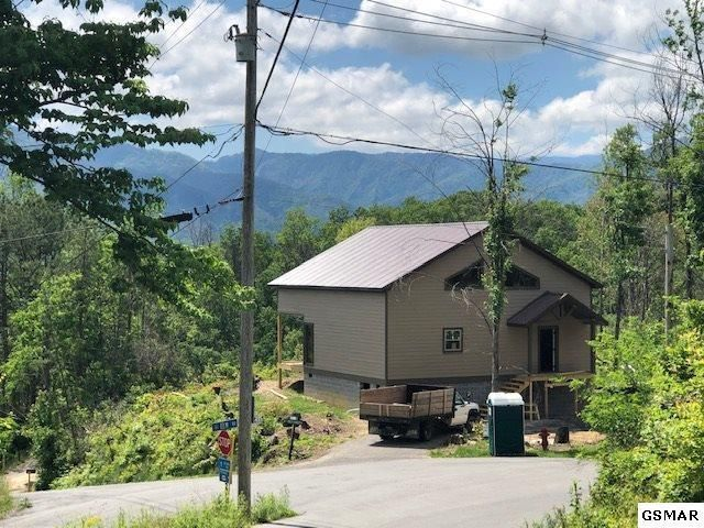 Views, Views, Views.  This property has an amazing view of Mt. LeConte!!  1 br 1 .5 bath with 1500 sq. ft.  This chalet has it all.  Vinyl plank floors, stack stone gas fireplace.  Open concept, L- shape kitchen with island, granite counter-tops, Large Master on the main level, covered porches both main level and upper level, large windows.  Level lot with circular driveway,  large loft with access to the upper deck with a spectacular view!!.  The lot is mostly level with great access, city water, etc.  ** sq. footage & acreage are assumed to be correct, but not guaranteed. As with all real estate transactions Buyers should do their  own due diligence and verify all information independently including possible HOA info.  Purchase Title insurance, get a survey and any other inspections.