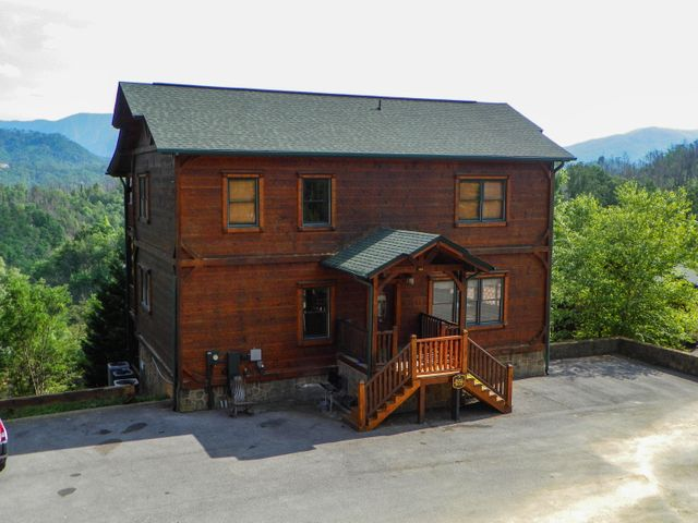 Located in Gatlinburg Falls Resort, this picturesque Log Cabin could be perfect for your Overnight Rental Investment or 2nd Home!This spacious cabin features 5 Bedrooms / 5 Baths, 4 Fireplaces, Rec Room, Media Room, Hot tub and Mountain Views. Only minutes from The Great Smoky Mountains National Park, downtown Gatlinburg and Pigeon Forge makes this location a prime area for those who appreciate having the cabin experience with just a short drive to the many local attractions.The Resort offers a pool, club house and all paved roads. Bring Family and Friends for a one of a kind Smoky Mountain Experience!