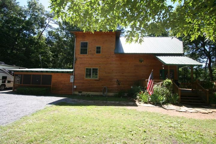 AWESOME LOCATION IN PIGEON FORGE!!! This spacious home comes with 4 bedrooms, 3.5 baths, and plenty of family living area! A small section of the home was done in 2002 and most of the home was built in 2014! Hardwood floors, open kitchen with all appliances included!!! Open decks, covered porch, screened porch, and two outside storage sheds once could be your workshop! Just minutes from it all!!! To see this property please call us today!