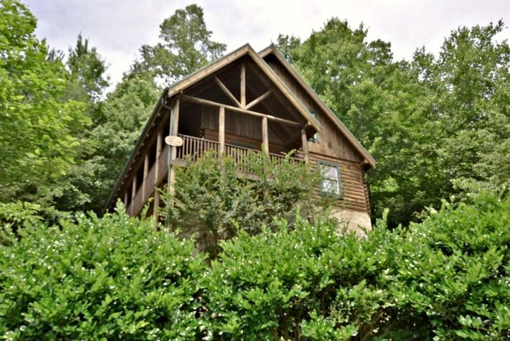 Wonderfully located, 2 bedroom 2 bathroom 1300 square foot log cabin located in a quiet resort community, only minutes from downtown Pigeon Forge. This property has a lovely deck with a hot tub where you can enjoy the peace and quiet of mountain living! The main floor houses a large great room with a fireplace, dining area, a full kitchen, a bedroom and bathroom. The spacious loft level has a recreational room with a pool table and foosball table and a bedroom with a private bathroom. Come see it today - before its too late! This home produced 37K in 2018 and 40K in 2017.