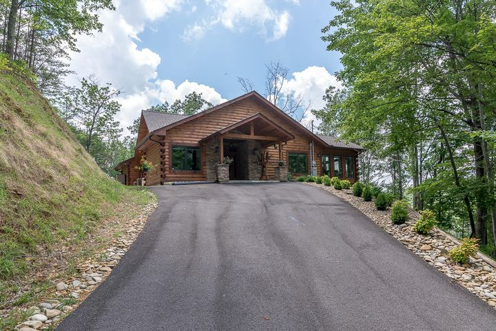 Completely custom built 3 bedroom, 3 bath cabin in Cobbly Nob! This beautifully built upscale home sits on a private, .79 acre lot with a gorgeous mountain view, private backyard, and extensive landscaping in the front. From the moment you enter the home, you will fall in love. Features include a custom upscale kitchen with upgraded tall cabinetry, upgraded appliances, and large built in fridge and freezer. The great room contains a 60-inch gas fireplace, upgraded tall windows, and upgraded window shades. Throughout the whole house you will notice engineered upgraded scraped wood flooring, First class Pella windows, upgraded lighting fixtures, and satin stain on the walls to enure very little darkening over time.