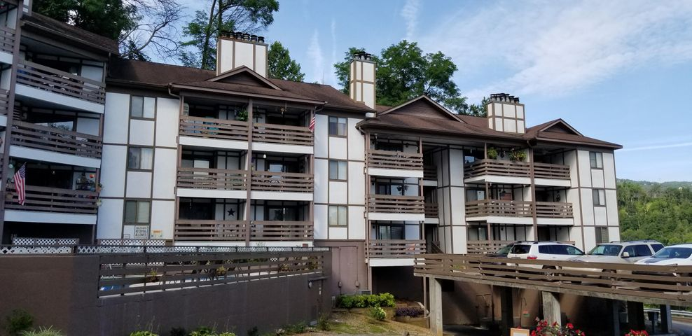 Have you dreamed of living in Gatlinburg?  Here is your chance!  See the Space Needle, Gatlinburg SkyLift and SkyBridge from your balcony!  Enjoy the 4th of July and New Years fireworks shows without leaving the comfort of your home!  This place has all of the benefits of mountain living, without having to climb those narrow mountain roads!  Walking distance to the Gatlinburg strip and a short drive to the National Park, Pigeon Forge attractions and Cades Cove!  Fully Furnished and Pool Onsite!