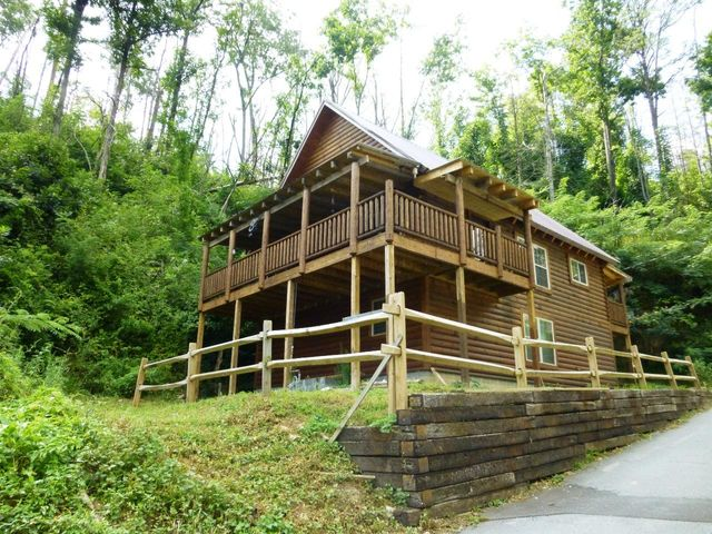 Location, location, location! This cabin has much to offer. Walk to the Alamo for lunch or dinner. Easy in and out of Gatlinburg. Lots of space in this 2 1/2 story, 3BR/2.5BA with 2800 SF. The all wood main level has a large master bedroom with a full bathroom attached, nice sized kitchen, a half bath, and living area. The living room has cathedral ceiling, a natural gas log fireplace and lots of windows to draw in the sunlight. Also has walk out to a covered front deck. The huge loft area would be a perfect game room. Currently used as a bedroom. Lower level has a rec room/family room with a gas log fireplace , a large bedroom, full bathroom and a laundry room/storage area. This level and the loft area offer you lots of flexibility to do what suits you or your vacation rental guests. So