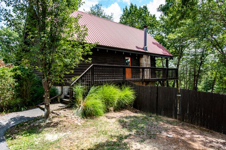 Cozy log cabin located just off the main strip in Pigeon Forge. Close to attractions, restaurants and shopping.  Open living room, kitchen, dinning room combo with stone, wood burning fireplace and hardwood floors. Enjoy the beautiful mountain view from the front deck. Wood floors have been recently refinished, and new carpet installed.