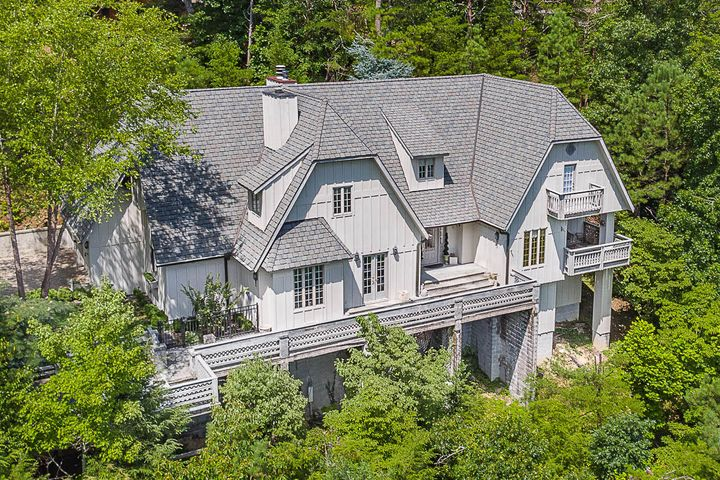 One of the most distinctive and impressive homes in all the Smokies, this classic French Chateau overlooking Greenbrier Pinnacle is ideal for the discerning buyer. The Loire-inspired design features soaring vaulted ceilings with hand-hewn post & beam supports, plaster walls, and antique heart of pine flooring.