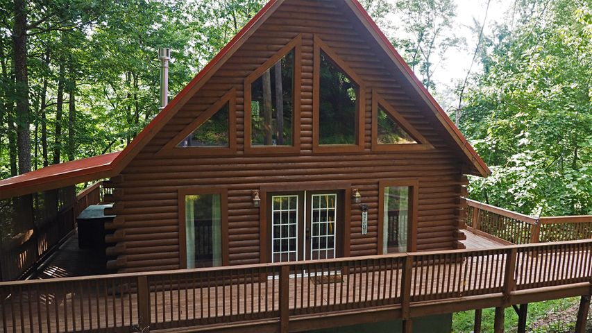 BEAUTIFUL LOG HOME WITH ADJOINING LOT & LEVEL PARKING LOCATED IN THE HEART OF GATLINBURG * BEING SOLD FULLY FURNISHED & EQUIPPED * SLEEPS (6) TURNKEY READY FOR OVERNIGHT RENTAL * WITHIN WALKING DISTANCE TO CHALET VAILLAGE, OBER GATLINBURG & LESS THAN 2 MILES TO DOWNTOWN GATLINBURG *  HANDICAP RAMP, MAIN LEVEL MASTER WITH FULL TILED BATH, NEW MATTRESS,  SPIRALING VAULTED CEILINGS * UPGRADES METAL ROOF, GUTTERS, STAINED EXTERIOR, 800+ SQ.FT. DECKING WITH COVERED PORCH & HOT TUB, NEW PRVIACY ROLLER SHADES, OIL LAMPS, SMART LOCK KEYLESS ENTRY, UPSCALE LEATHER FURNITURE, MEMORY FOAM HIDEABED, DINING TABLE WITH PULL OUTS,  LOFT OFFERS 2ND BEDROOM WITH 1/2 BATH & 1400 GAME ARCADE, NEW WASHER, DISHWASHER, KITCHEN FAUCET, WATER HEATER, 55'' & 40'' FLAT SCREEN TV'S, LINEN'S, DRAPES & DECOR..