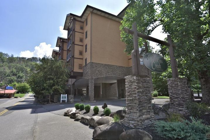 Condo Unit 201 in the Baskins Creek Complex located at 215 Woliss is managed by Wyndham Vacation Rentals.  This spacious and luxurious two bedroom and two bath unit is in the Heart of Gatlinburg within walking distance of several top name attractions such as Ripley's Aquarium of the Smokies and Anakeesta Theme Park. All units in the Baskins Creek Complex have similar floor plans and share the Wyndham Rental Management marketing and oversight.  Rental numbers are good and projected to grow.  The large living area is complete with a large gas masonry fire place and flows into the full kitchen giving the open space to share vacation memories. The great room area has tile and vinyl plank flooring as an upgrade over carpet.  The master suite style bedroom has a whirlpool tub and private bath.