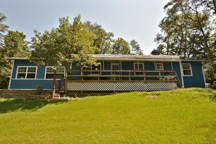 Private, cozy, well-located, 3 BD/1.5 BA contemporary-style ranch home, located just mere mins. to Dollywood & Pigeon Forge. Ideal as a permanent or 2nd home, or as an overnight rental - tremendous rental potential in a private & beautiful wooded location, creating a real sense of mountain living at its finest. Has a good-sized 1-car attached garage, as well as outdoor storage, a large deck area, & a smaller deck area, where you can see the fireworks from Dollywood from this 1 acre property. Property also has a small nature trail, along w/ample front & rear yard space! Inside this home, located all on one level, you have a large kitchen/dining room, complete w/a free-standing F/P, a large living room, 3 BD's w/each having its own closet space, a 2nd & 3rd BD sharing a HBA between them.