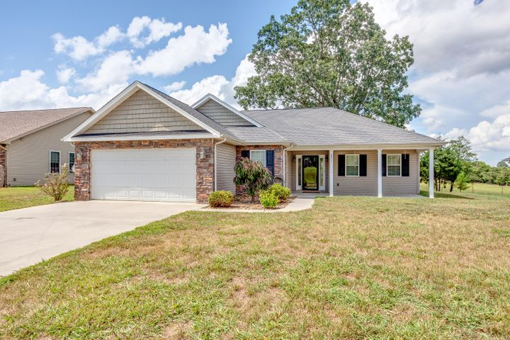 LOOKING FOR A WELL-MAINTAINED RANCHER IN THE HEART OF SEVIERVILLE - then look no further! This 3 bed, 2 bath home lays on a level lot, has gorgeous curb appeal, NO steps, & several upgrades throughout. Walking through the front door, you'll notice the beautiful hardwood flooring, vaulted ceiling, & the open concept in the living, dining & kitchen area. The spacious living area features a gas fireplace, overlooks the private backyard & leads out to a screened patio area. The kitchen features custom cabinets, granite countertops & SS appliances. The master suite has trey ceilings, spacious master bathroom w/ dual sinks, jetted tub, walk-in shower & closet. You'll find the other two bedrooms & full bath on the other side of the home (split floorpan). This home won't last long - call today!