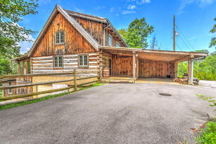 Beautiful cabin in a serene setting providing privacy and a picturesque view. This home will surely be one to Wow you! It is located on a spacious 2.4 acres/2 lots which is convenient for those who love to soak in the nature surrounding them. The rustic charm will draw you inside to all this home has to offer. Enjoy a Master on the Main Level, 2 Loft Style bedrooms, a great sized deck, sunroom, wood burning fireplace and so much more. To top it off, a finished basement comes ready with a workout room, extra bedroom/office and bath. You won't want to miss an opportunity to view this home!