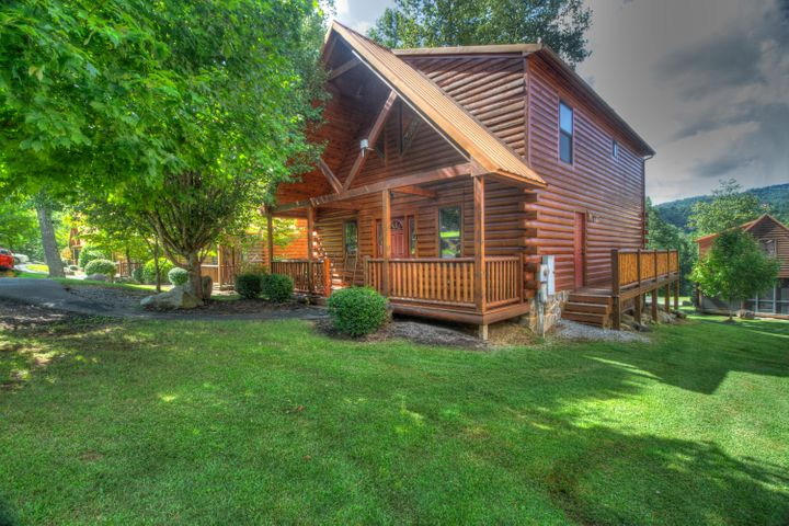 Currently on an existing overnight rental program with income totaling close to $33,000 from August 2018 to August 2019.   White Oak Cabin has an open floor plan ideal for entertaining family and friends.  Guests will enjoy upscale furnishings and handcrafted interior, and expansive vaulted ceilings. TVs and DVD players are throughout the cabin as well as wireless internet. White Oak Log Cabin accommodates up to six guests with 3 bedrooms and 2 full baths. The master bedroom has a king size bed with luxury linens in the master bedroom, and the two guest bedrooms have queen size beds.White Oak has a fully stocked kitchen  with granite counter tops and upscale appliances.   White Oak also has a washer & dryer.  Outside, guests will enjoy the beautiful covered front porch with rocking chairs,