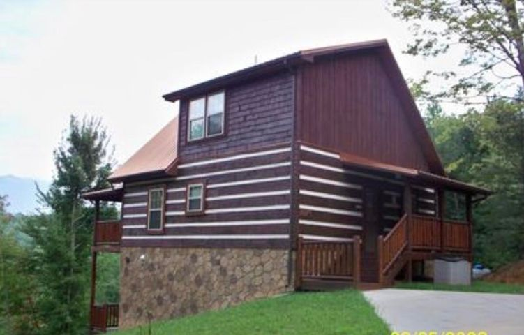 Indoor-Heated Pool cabin nestled in the heart of the Arts & Crafts community and only minutes from downtown Gatlinburg. This cozy honeymoon cabin is very private yet convenient access to all the local attractions of the area including the Great Smoky Mountain Park. Rustic stone gas fireplace, pool table, SAUNA room, Heart-shaped Jacuzzi and when your ready to relax, step outside on the back deck and soak your cares away in your private HOT Tub. Enjoy year-round beautiful Mountain VIEWS from your back deck as you swing, BBQ a meal, or soak in your hot tub, are sure to take you away into relaxation at best. When your ready to make a bigger splash,  head downstairs to your own private heated pool or relax in the Sauna. This turn-key cabin has everything in place. Call for your viewing today!