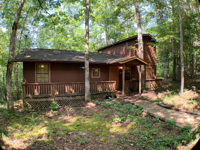 Could this be that diamond in the rough that you have been looking for? A Sevier county cabin in the woods sitting on over three and a half acres for this price does not come along that often. This is a three bedroom, two bath home that can be remodeled to your taste and specifics. This home is being sold as-is with no guarantees or warranties. It is priced to sell and ready for your special touches that can turn this into a successful rental cabin or a personal vacation spot, located less than thirty minutes from area attractions such as Dollywood. Call your Realtor today and schedule a showing!