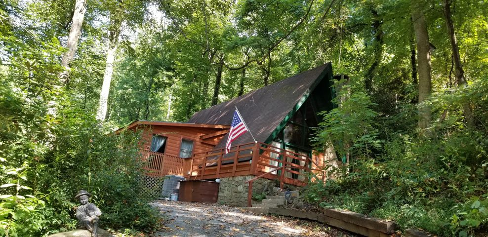THIS IS YOUR AUTHENTIC GATLINBURG A-FRAME CHALET! Only 2 MILES FROM TOWN on HISTORIC SKI MOUNTAIN ROAD is a 2 bedroom 1.5 bath chalet that is ready to be your second home or your potential rental property. Some repairs may be required to make it an over night rental, but seller had it rented LONG TERM for 1250 per month! Just a short drive UP THE MOUNTAIN to OBER GATLINBURG ski area and amusement park...so MUCH TO DO and the roads on ski mountain are always plowed for your guests! Come experience all Gatlinburg has to offer! Property has 1 bedroom 1 full baht on main level and an upper bedroom and half bath upstairs. Dining room, and open A-FRAME LIVING ROOM with stone wood burning fireplace! Call today! LET'S GET STARTED ON YOUR DREAMS!