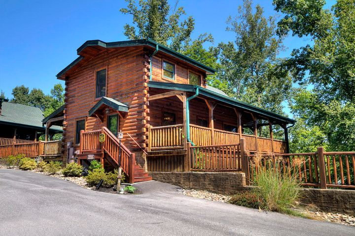 GROSS RENTAL INCOME OF ~$62,745.76 IN 2018. LUXURY 3BR 3BA Cabin with a HUGE GAME room, walking distance to a Gatlinburg trolley stop. When you enter through the hall, you will see the spacious Kitchen with charming vintage-look stove, and the Grand Living Room with Cathedral ceiling, Gleaming Wood floors and floor to ceiling stacked stone fireplace to your left. 3 SPACIOUS BEDROOMS - one on each level. The 2nd Level Master has a bubbling whirlpool tub & a cozy fireplace. Downstairs has a huge game room and the third bedroom with its own private bathroom. Take a relaxing dip in the outdoor hot tub, or enjoy the rockers on one of the two covered decks. HOA covers Water/sewer, as well as the roads and lawn maintenance. Resort is a short drive away from Pigeon Forge and downtown Gatlinburg.