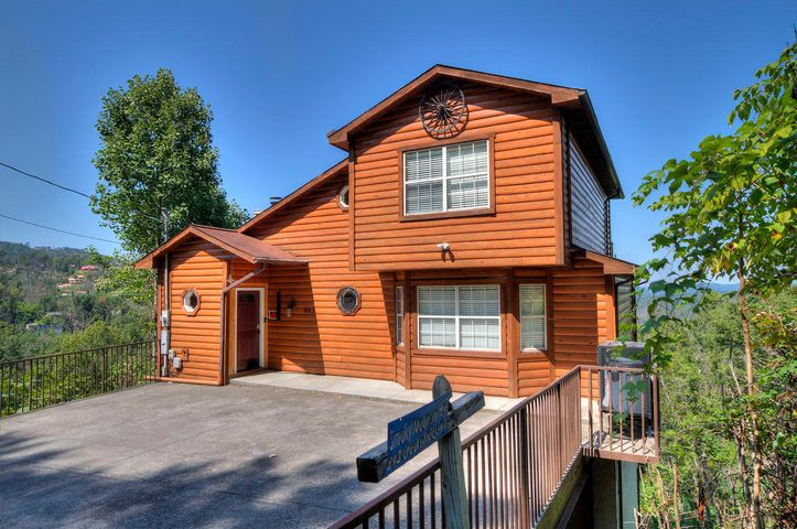 GROSS RENTAL INCOME OF $89,699.95 in 2018. REMODELED 6 Bedroom 5 Bath with GREAT VIEW in Chalet Village! Open Floor Plan, 3 decks. 4 bedrooms have their own private bath and 2 share a bath. LARGE GAME ROOM with pool table & foosball table. Master BR is on the main level. Great Location, 8 minutes to Downtown Gatlinburg, 7 min to skiing, and only 10 miles to Dollywood. Plus you get to enjoy all the amenities of Chalet Village, 2pools, tennis courts. And of course the Great View from all 3 decks and many of the rooms. You get all this with water and paved, city maintained roads! New HVAC in 2017, New Water Heater 2017, New kitchen appliances September 2016.
