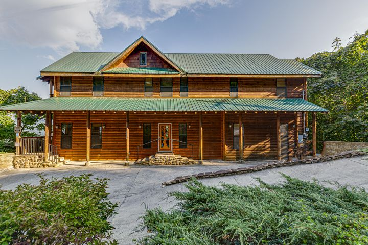 Rental projection $110,000 as-is and $130,000 with interior decor and minor upgrades.The views are endless in this beautiful cabin, overlooking the Tram, Gatlinburg, and the Great Smoky Mountains. Excellent income producing fully furnished cabin! 5BR/5.5 Bath sleeps 17.  SmokeRise Lodge is a spacious mountain cabin nestled on a high ridge with a beautiful panorama of the Smoky Mountains. This spacious cabin offers designer furnishings, 2 Stone Fireplaces, enormous Game Room, and a warm, comfortable atmosphere.  Two Hot Tubs, Movie Area in the Game Room, and three decks for relaxing. Tons of room for family and friends. Smokerise Lodge is only a short drive to both Ober Gatlinburg Ski Resort and downtown Gatlinburg.
