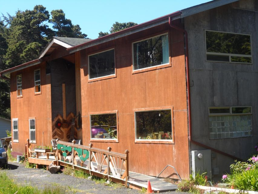 214 NE Camp One Rd, Yachats, OR 97498 - Unfinished front of home