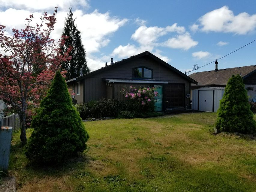 363 SE Egbert Ave, Siletz, OR 97380 - Front of home from Angle