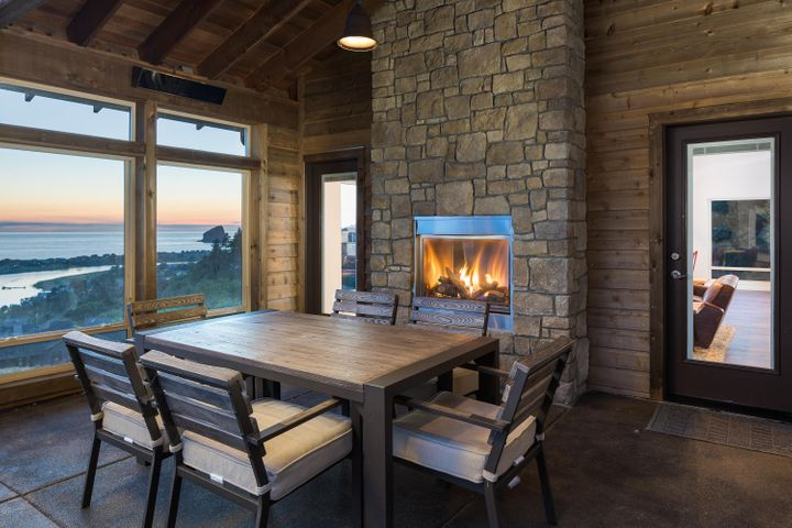 Protection from the elements with outdoor heaters and fireplace