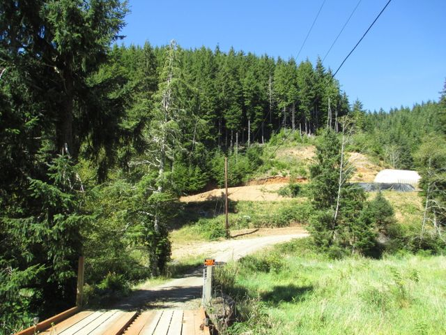 Timber Conservation land with Power, Septic, Well on property.