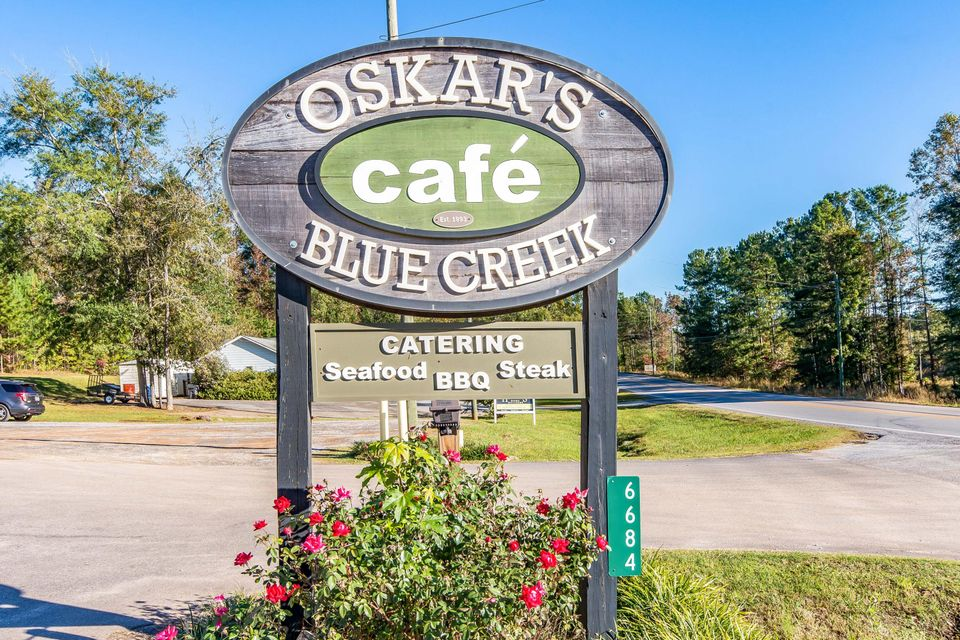 Successful Oskar's Restaurant 25 yrs in business with 275 ft plus of road frontage and 2. plus prime acres located in the heart of Blue Creek . Comes complete with Building ,125 person seating capacity , equipment catering,concepts and processes , recipes , water treatment system , P O S with video interface and all systems contained in building.