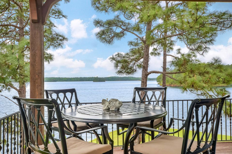 THE PERFECT LAKE MARTIN LAKE HOME! What you have been waiting for so be the early bird on this Longleaf beauty! If you want VIEW, then you can't get much better than this! If you want location, spot on!, Great neighborhood... Got it!, Perfect size home and move in ready.... got you covered.  just minutes from Chimney Rock.Point lot,very gentle slope,BIG WATER VIEW,DEEP WATER,with the sought after LAKE STYLE.4bd/4.5 bth,2 stories with Master on the Main,two living areas, one up and one down, nice size dining area, wonderful kitchen with breakfast bar,  screened porch,2 LARGE covered decks, hardwood floors,granite and quartz,mature landscaping,and lots of windows for great views.Double garage Floating boat pier, boat lift, swim steps and slip with sunning deck. This one won't last long.