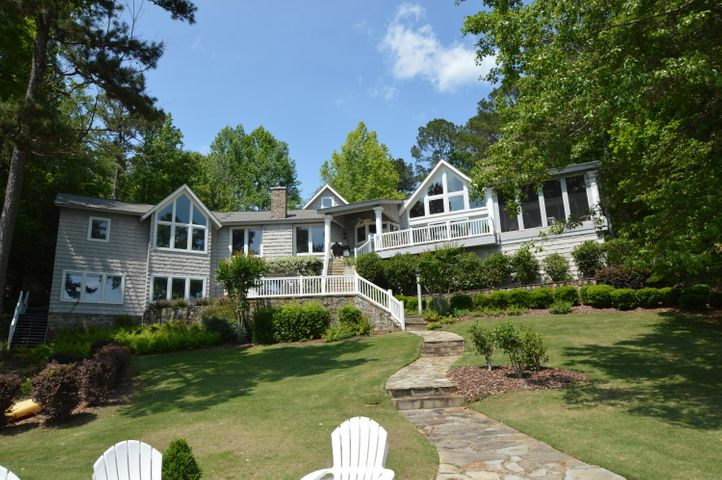 The gorgeous home sits on a fabulous lot with amazing views, deep water all year long, and 179 ft of shoreline.