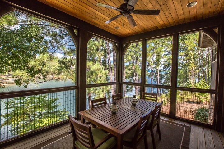 It's a short jaunt to anywhere you want to go on this lot...overlook the water from the main level screened porch...