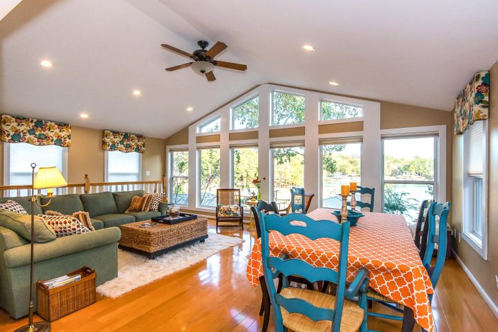 Lovely view of Lake Martin in vaulted living area with hardwood floors. 3bdrm/2bath located in Holiday Shores.