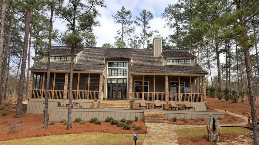 Lakeside view of 40 Ridge Point. The perfect lakeside porch setup with both open air and screened. Huge fire pit. Flat lakeside yard. Many good features.