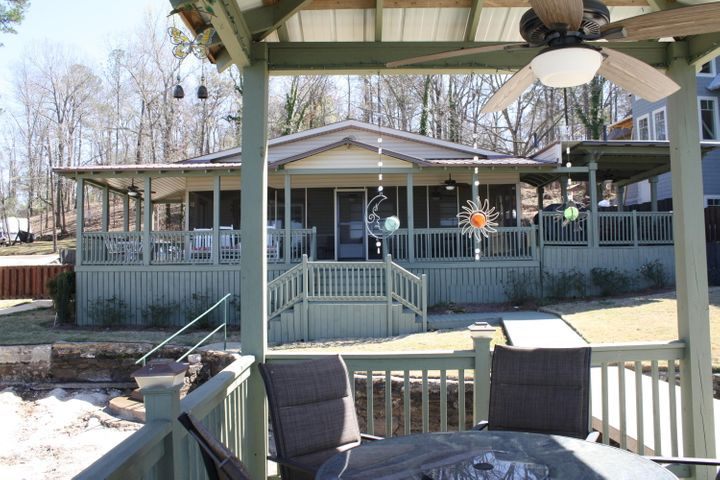There is a dining and grilling area to the right of the screen porch