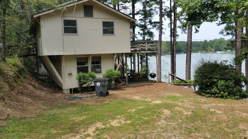From the side yard. Boat ramp to the right
