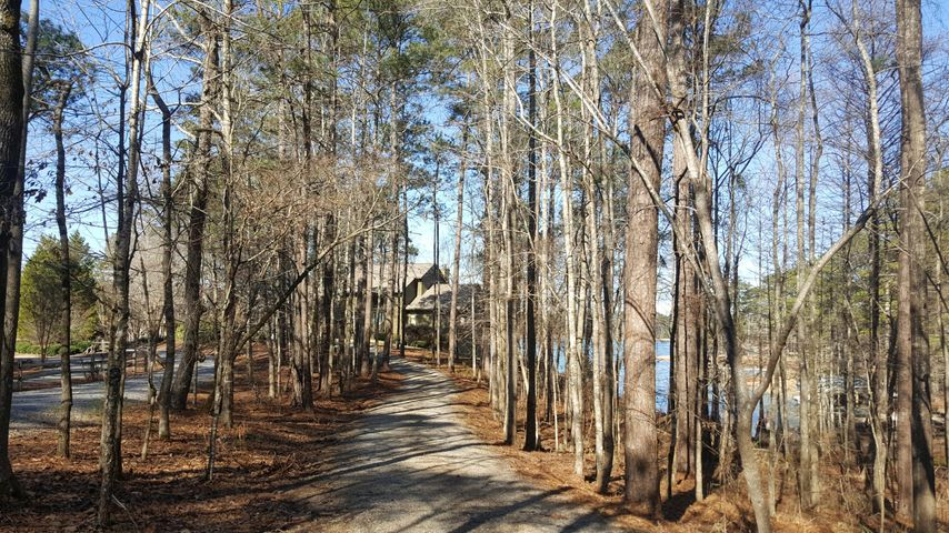 More than 2 acres of mature trees and natural landscaping surround this home.