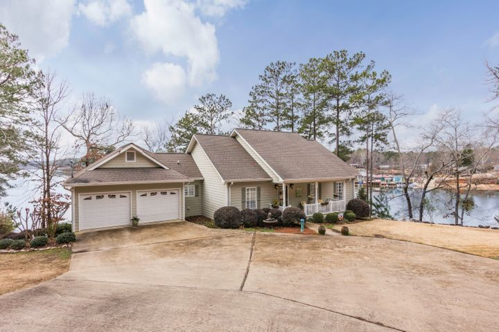 Welcome to 682 Bay Pine! Log views, natural yard, great location.