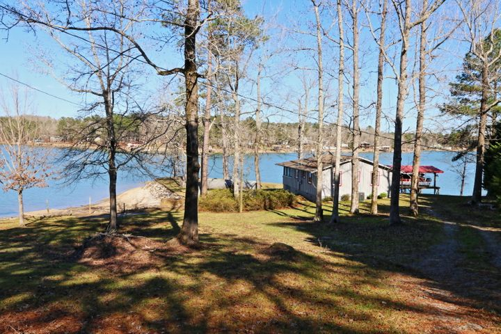Lake Martin cabin on large point lot in Little Kowaliga. Big water views in every direction.