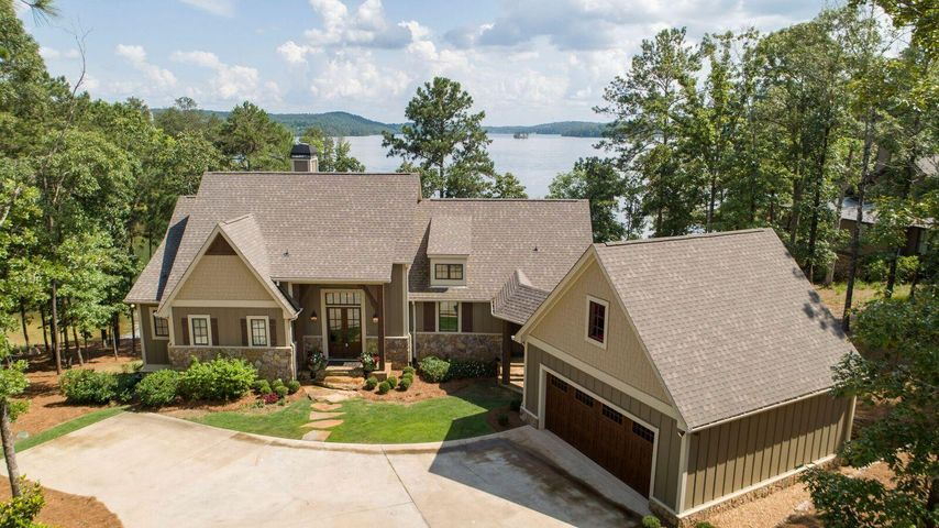 The entrance to the home is just as smooth as the entrance from to water on the lakeside. Just a few flat steps to the front door.