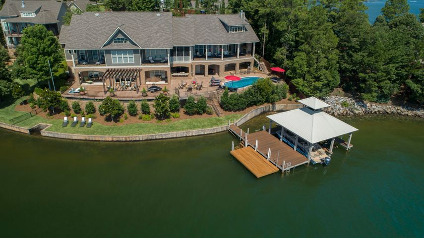Sweeping Lake Martin views, located in the Heart of Lake Martin , this truly Fabulous Lake home is a must see .  Enter through your private electronic gate. Plenty of parking with a oversize double car garage ! Wake each morning to a Glorious sun rise over looking Professionally landscaped grounds that surround an Awesome Outside entertainment area that features a Lakeside pool, covered Cooking porch, Fire Pit , Hot Tub , and multiple outside decks designed for entertaining as well as comfort and fun ! An easy walk to a Double Covered Boat House with boat lifts , PWC lifts and Floating Dock . This home also features Bedrooms , 5 Baths , Chefs Kitchen , 2 Pantries , Full Bar , 2 Laundries , Wine Closet , Movie Theater , Workout room , and Sleeping Loft with full bath and dressing closet !