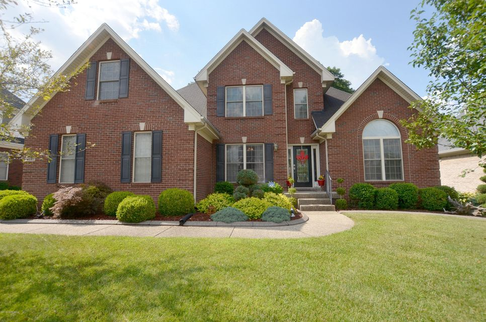 Welcome home to this spectacular well kept home in Forest Springs North conveniently located near shopping, schools, entertainment and the interstate.  The natural light foyer with hardwood flooring leads into a carpeted great room with soaring 20 foot ceilings, enormous palladium windows and beautiful woodwork.  To the right of the foyer...