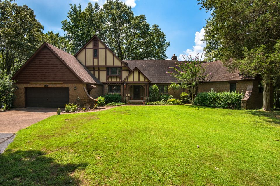 Significant price reduction, originally $1,250,000 and reduced to settle estate. Escape the city to this sequestered lake front home offering ultimate privacy. Frank Lloyd Wright inspired, Tudor Revival style home nestled on the shores of Kentucky Lake and secluded by water and nature. Distinctive, waterfront home was originally built by developers of Cedarling Hills Subdivision. In addition to nearly two acres of land, home is surrounded by an additional two acres of federally protected, TVA land. Original developer maximized all views of the water and privacy while positioning the home to take in both the sun rise and sun set. Home itself is truly an architectural gem with original leaded windows, built-in floor to ceiling book cases, inlaid wood floors and barrel ceilings.