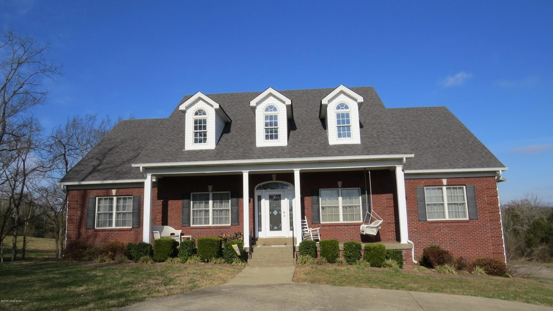 RARE FIND! Quality custom built ALL BRICK RANCH home with WALKOUT BASEMENT on 5+ gorgeous ACRES in Eastern Jefferson County! PARK LIKE SETTING and PRIVATE VIEWS FROM EVERY WINDOW. Welcoming FRONT PORCH entry and two story foyer and impressive great room with fireplace. Gleaming HARDWOOD flooring through most of main level. True family home with 5 Bedrooms, 3.5 baths and 5+ acres to play.  Gourmet kitchen with an abundance of CABINETS, pantry, island with barstool seating area and breakfast dining area with access to large COVERED DECK. Formal dining room too. Perfect setup for entertaining!  Impressive FIRST FLOOR MASTER BEDROOM with trey ceiling, his and her walk in closets, and  numerous windows. Master bath with two vanities, separate shower and jetted WHIRLPOOL TUB.