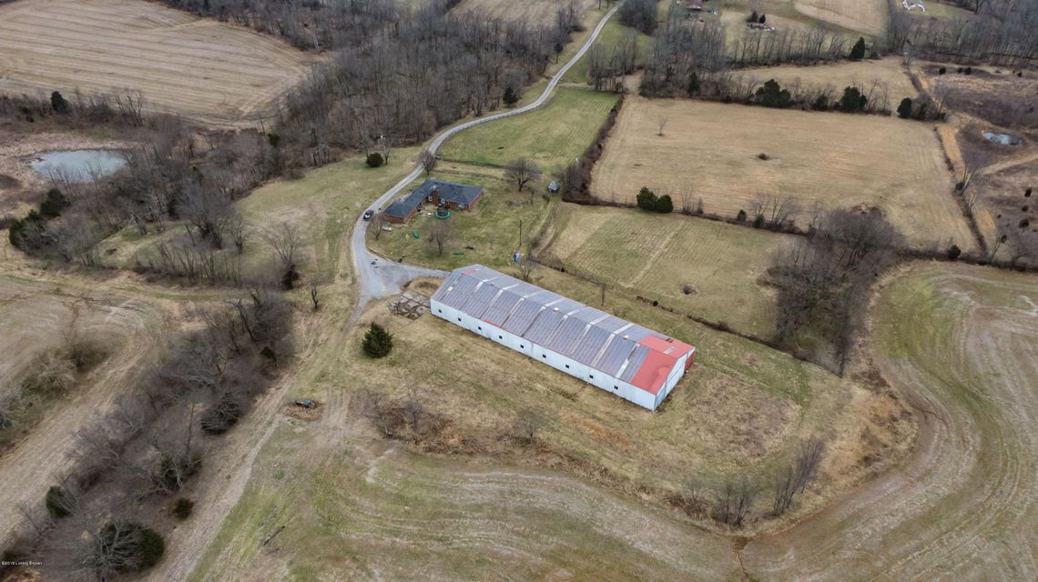 Prime farm in Simpsonville, KY with 140 acre of lush crop ground and good road frontage for possible division.  This is in the heart of horse country and there is a 62x210 horse facility with 20 stalls and riding area.  The home on the farm is a brick ranch approx. 2200 sq ft of living area with a basement, 3br 2ba and in good shape.   This...
