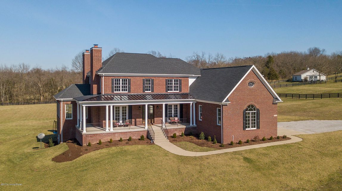 This exquisite custom built home is less than two years old and features all the upgrades and amenities one could ever dream of! Enjoy the privacy of nearly 7-acres of lush, green rolling land with four board fencing and the convenience of of the Gene Snyder, grocery and retail shopping located less than six miles away. The Parklands, Big Beech Woods at Pope Lick Park is located just to the north of the property, providing fantastic hiking trails and additional outdoor recreational space. The sprawling open floor plan features a divine first floor master with sitting area, fireplace, built in laundry, and spa like master en suite. The kitchen is chef inspired with gorgeous, custom, soft closing cabinets, 6-burner gas cook top, stainless appliances, coffee and wine bar, breakfast nook
