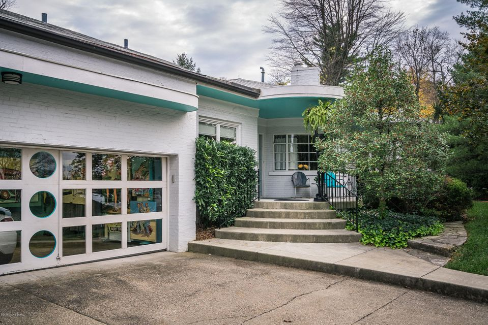 A iconic, amazingly preserved and maintained Louisville midcentury modern home. The spacious living room with fireplace is open to a dining area with built-in shelving and cabinetry. The retro eat-in kitchen has, granite counters, glass tile backsplash, and original semi-circle bench seating. Each bedroom is large with access to a full bath...