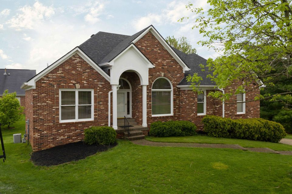 There is over 3000 finished square feet in this fantastic 4 bedroom, 3 full bath walkout brick ranch home that sits at the end of a cul de sac in the Springhurst subdivision. Step into the foyer that has custom inlaid wood flooring and right away you notice the see through fireplace that shows on both sides of the dining room (12 ft ceilings)and the vaulted ceiling living room. The Master bedroom is a substantial size and has the softest carpet I've ever stepped foot on. The master bath has two sinks, shower, tub, water closet, linen closet, and through the bathroom is an enormous master closet!!  This floor plan is split and the other two bedrooms and full bath are on the left side of the house.