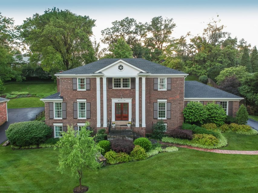 This gorgeous Indian Hills home has it all. The main level showcases a large entry flanked by the formal living room on one side and formal dining on the other. The eat-in kitchen showcases great space and tons of natural light with gorgeous backyard views. The first floor also includes a wood burning fireplace with gas starter, hard wood...